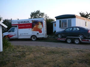 Loaded Moving truck in front of the mobile/trailer I lived in in Brant Alberta
